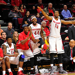 (R-L) Kadeem Jack #11, J.J. Moore #44 and Malick Kone #0 of the Rutgers Scarlet Knights look on from the bench during the second half of Rutgers men's basketball vs Temple Owls in American Athletic Conference play on Jan. 1, 2014 at Rutgers Louis Brown Athletic Center in Piscataway, New Jersey.