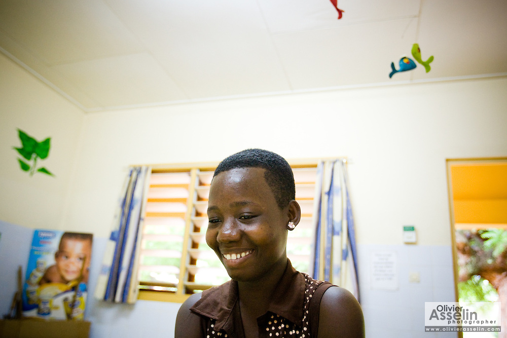 Koffi Aya Rose, 19, smiles after testing negative for HIV at the NDA health center in Dimbokro, Cote d'Ivoire on Friday June 19, 2009.