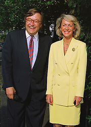 MR DAVID MELLOR the former Conservative MP for Putney and PENNY, VISCOUNTESS COBHAM, at a party in London on 25th June 1998.MIT 20