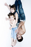 father and daughters studio portrait on white isolated background