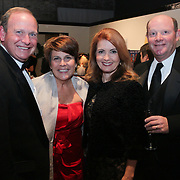 Jack Richardson, left, Gail Richardson, left-center, Val Anderson, right-center, and Scott Anderson pose for a picture during the Diamonds and Champagne Hope Ball Saturday November 22, 2014 at the Coastline Convention Center in Wilmington, N.C. (Jason A. Frizzelle)