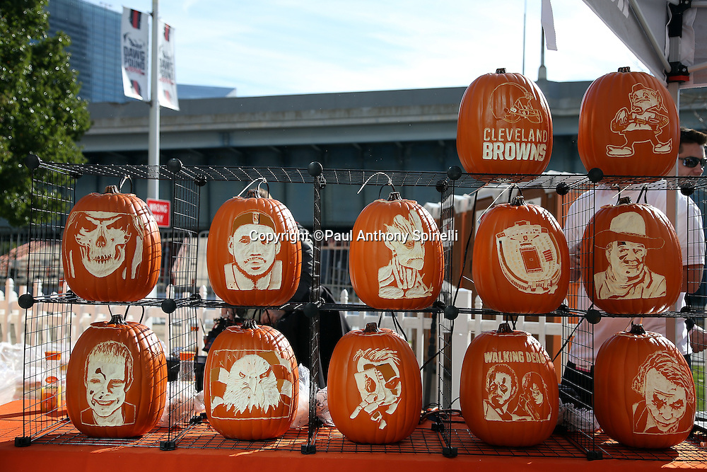 Pumpkins are carved with Halloween figures in this photograph taken on the pedestrian plaza outside FirstEnergy Stadium before the Cleveland Browns 2015 week 8 regular season NFL football game against the Arizona Cardinals on Sunday, Nov. 1, 2015 in Cleveland. The Cardinals won the game 34-20. (©Paul Anthony Spinelli)