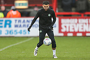 Forest Green Rovers Dominic Bernard(3) <br /> warming up during the EFL Sky Bet League 2 match between Stevenage and Forest Green Rovers at the Lamex Stadium, Stevenage, England on 26 December 2019.