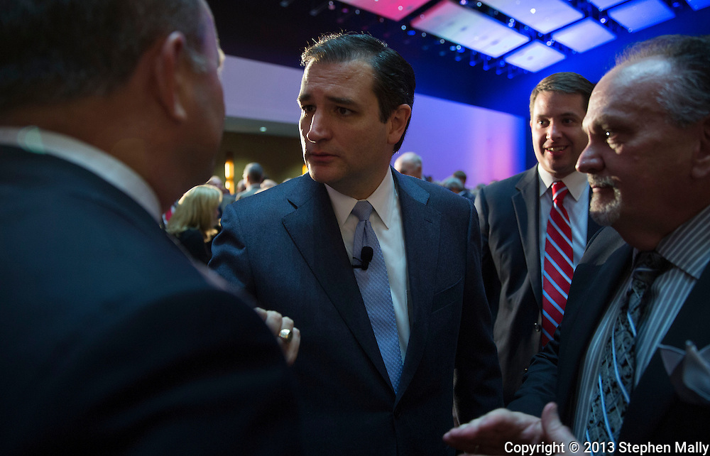 DES MOINES, IA - OCTOBER 25, 2013: Senator Ted Cruz, Republican of Texas, talks with people after speaking at the Iowa GOP Ronald Reagan Dinner at the Iowa Events Center - Community Choice Credit Union Convention Center in Des Moines, Iowa.