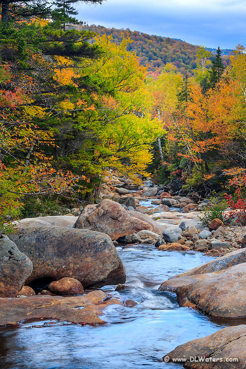 Beautiful fall rapids along the Peabody River at the base of Mount Washington in the White Mountains, NH.