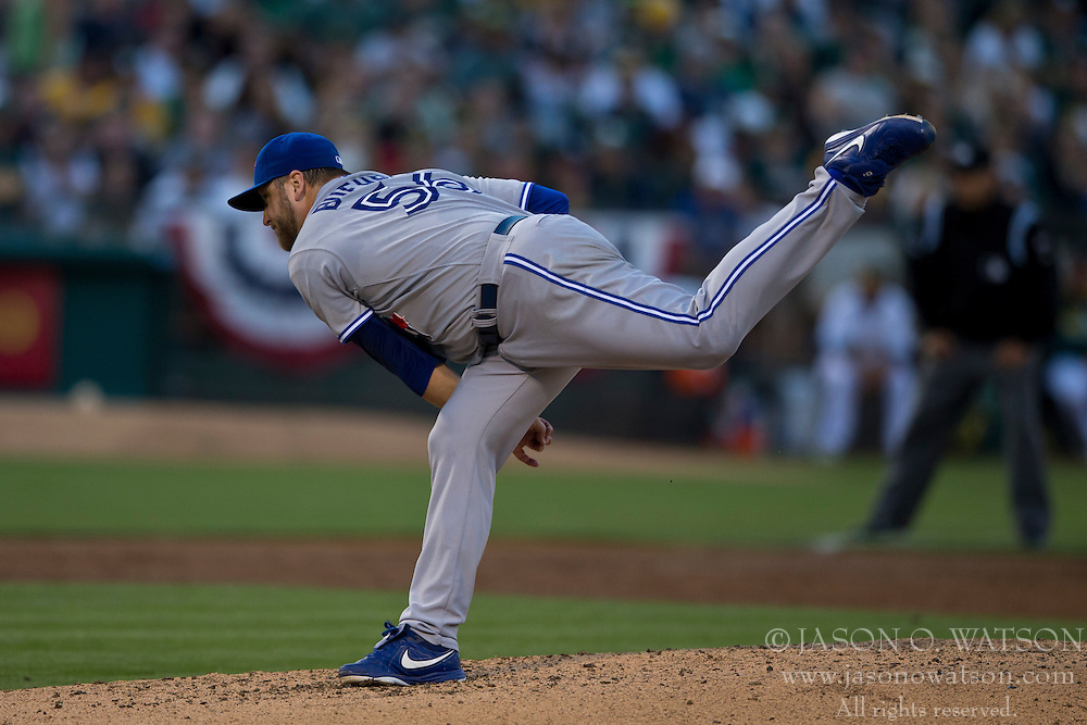 OAKLAND, CA - JULY 05:  Mark Buehrle #56 of the Toronto Blue Jays pitches against the Oakland Athletics during the third inning at O.co Coliseum on July 5, 2014 in Oakland, California. The Oakland Athletics defeated the Toronto Blue Jays 5-1.  (Photo by Jason O. Watson/Getty Images) *** Local Caption *** Mark Buehrle