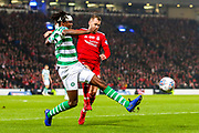 Dedryck Boyata (#20) of Celtic clears the ball under pressure from Niall McGinn (#10) of Aberdeen during the Betfred Cup Final between Celtic and Aberdeen at Celtic Park, Glasgow, Scotland on 2 December 2018.