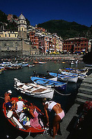 2000, Vernazza, Italy --- People Taking Out a Boat --- Image by © Owen Franken/CORBIS