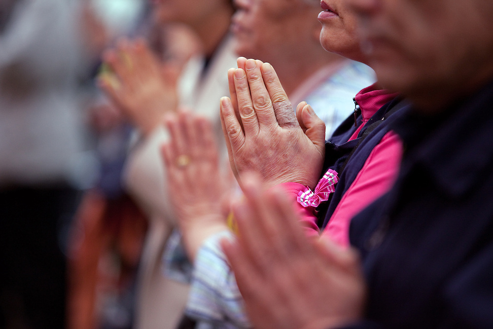 "Seoul/South Korea, Republic of Korea, KOR, 02.05.2009: People praying in  a temple in the center of the korean capital Seoul during the celebrations of Buddhas birthday (2nd of May 2009) which is celebrated according to the Lunisolar calendar. This day is called ""Seokga tansinil"", meaning ""the day of Buddha's birthday""."