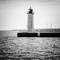 Milwaukee Pierhead Lighthouse photo in black and white. The lighthouse is located in Milwaukee, Wisconsin on Lake Michigan, one of the Great Lakes. Image is high resolution.