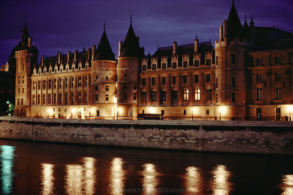 Le Conciergerie, the former prison on the Ile de la Cité at dusk on the banks of the Seine River, Paris, France.