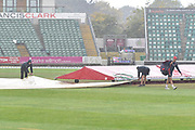 Groundstaff putting the covers on as heavy rain starts to fall ahead of play during the Specsavers County Champ Div 1 match between Somerset County Cricket Club and Essex County Cricket Club at the Cooper Associates County Ground, Taunton, United Kingdom on 26 September 2019.