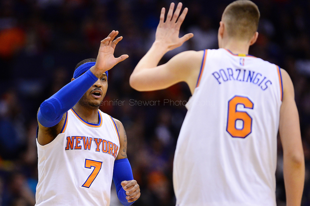 Mar 9, 2016; Phoenix, AZ, USA; New York Knicks forward Carmelo Anthony (7) high fives forward Kristaps Porzingis (6) in the first half of the NBA game against the Phoenix Suns at Talking Stick Resort Arena. Mandatory Credit: Jennifer Stewart-USA TODAY Sports