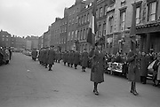 Flanked by high ranking army officers wearing mourning bands, the remains of Cardinal pass hundreds of people who lined the funeral route in O'Connell Street. The cardinal was buried in St Patrick's Cathedral, Armagh. <br /> 02.02.1963