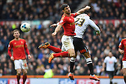 Nottingham Forest defender Bojan Jokic and Derby County midfielder Tom Ince battle in the air during the Sky Bet Championship match between Derby County and Nottingham Forest at the iPro Stadium, Derby, England on 19 March 2016. Photo by Jon Hobley.