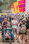 Hot work getting around the arena - The 2018 Latitude Festival, Henham Park. Suffolk 13 July 2018