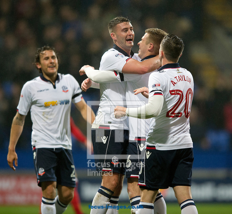 Gary Madine of Bolton Wanderers (2nd left) is congratulated by his team-mates after he made it 1-0  during the Sky Bet League 1 match at the Macron Stadium, Bolton<br /> Picture by Russell Hart/Focus Images Ltd 07791 688 420<br /> 12/12/2016