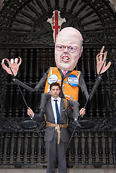 London, June 16th 2014. A protester supports an effigy of Justice Minister Chris Grayling at the entrance to the Old Bailey, as lawyers, law students and barristers protest against cuts to legal aid budgets.