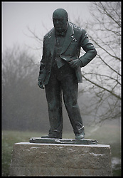 Snow falls in on the Winston Churchill Statue in Woodford Green, Essex, Friday January 18, 2013. Photo: Andrew Parsons / i-Images