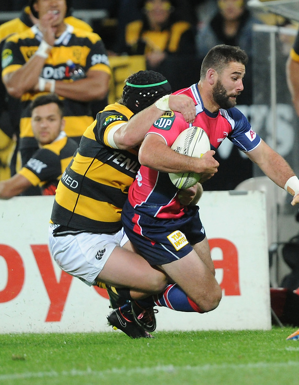 Tasman Makos Billy Guyton tackled by Taranaki's Mitchell Crosswell in the ITM Cup Rugby Premiership final match at Yarrow Stadium, New Plymouth, New Zealand, Saturday, October 25, 2014. Credit:SNPA / Ross Setford