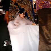 A Bedouin bride is waiting for friends and relatives to accompanying her on the final day  of the wedding celebrations.