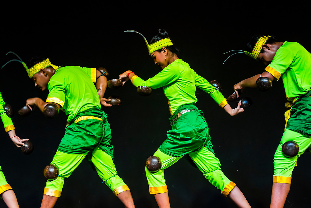 Praying mantis dance (Robam Kandob Ses). The gestures  largely imitate the praying mantis and costumes are the color of the insect. Traditional dance show presented by Cambodian Living Arts, National Museum of Cambodia, Phnom Penh, Cambodia.