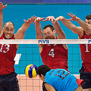 USA block party of Clayton Stanley(13) David Lee(4) and Matthew Anderson(1) sends back the shot by Puerto Rico's Hector Soto(12)in the World League Match at the Walter Pyramid, Long Beach, Calif., Friday, July 1, 2011.
