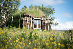 19 July 2017, Tjuonajokk, Lapland, Sweden: The camp features replicas of traditional Sami cottages, built on the hillside by Mount Ruovas.