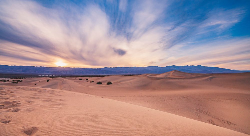 Sunset and dramatic clouds over these iconic sand dunes at the edge of Death Valley