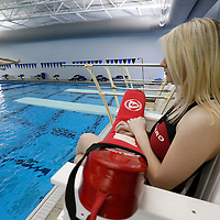 Thomas Wells | BUY at PHOTOS.DJOURNAL.COM<br /> Lifeguard Lauren Wilson, right, watches closely as area students like Kaream Hurst, 11, kick off their spring break at the Tupelo Aquatcic Center on Monday.