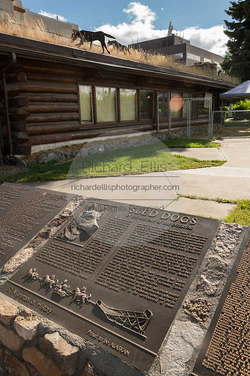A plaque dedicated to Sled Dogs outside the Yukon Quest Dog Sled Race headquarters in Golden Heart Plaza downtown Fairbanks, Alaska. The 1,000-mile-long Yukon Quest International Sled Dog Race starts each year in the park.