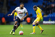 Bolton Wanderers midfielder Liam Trotter carries the ball under pressure from Stuart Dallas of Leeds United during the The FA Cup fourth round match between Bolton Wanderers and Leeds United at the Macron Stadium, Bolton, England on 30 January 2016. Photo by Simon Brady.