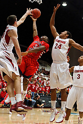 Nov 14, 2011; Stanford CA, USA;  Stanford Cardinal forward/center Jack Trotter (left) blocks a shot from Fresno State Bulldogs guard Kevin Olekaibe (3) during the first half of a preseason NIT game at Maples Pavilion. Mandatory Credit: Jason O. Watson-US PRESSWIRE