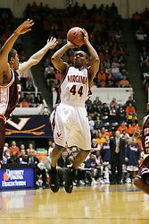 Sean Singletary (44) shoots a jumper over a Hokie defender.  Singletary had 23 points on the game as the Hoos defeated VT in overtime, 81-77.
