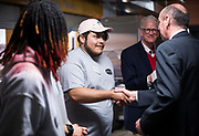 Operation Fresh Start student Ismael Cid shakes hands with Executive Director Greg Markle during the grand opening ceremony for Operation Fresh Start on Milwaukee Street in Madison, WI on Thursday, April 11, 2019.