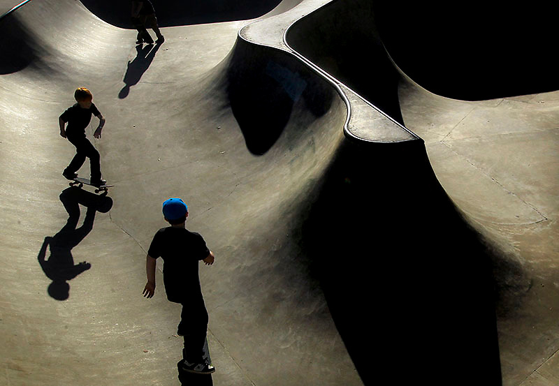 Jailon Bailes, left, Matthew Whittle, top, and Scott Pieroni test their skills in the bowl at Riverview Skateboard Park in North Little Rock on Feb 3, 2013.