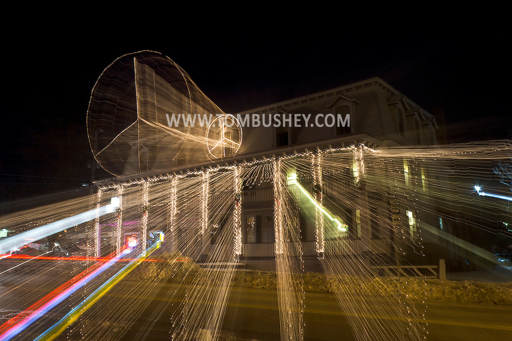 Wurtsboro, New York -  Holiday lights shine outside Danny's Village Inn on the night of Jan. 1, 2013. The lights are streaks because the lens was zoomed during the long exposure. ©Tom Bushey / The Image Works