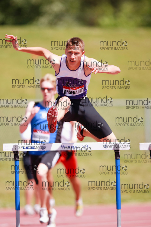 Winnipeg, Manitoba ---11-07-10--- Calvin Arsenault competes in the 400 meter hurdles at the 2011 Canadian Junior National Track and Field Championships in Winnipeg, Manitoba,  July 10, 2011..GEOFF ROBINS/ Mundo Sport Images.
