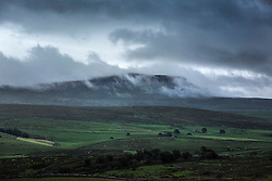 © Licensed to London News Pictures. 26/08/2015. Ribblehead, UK. Picture shows clouds covering the Pen-y-Ghent mountain in the Yorkshire Dales first thing this morning. Photo credit: Andrew McCaren/LNP