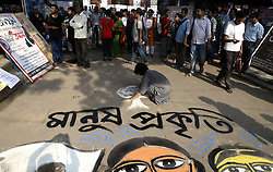 July 6, 2018 - Kolkata, West Bengal, India - Artists paint on street to protest against Mandsaur rape incident in front of Academy of Fine Arts. (Credit Image: © Saikat Paul/Pacific Press via ZUMA Wire)