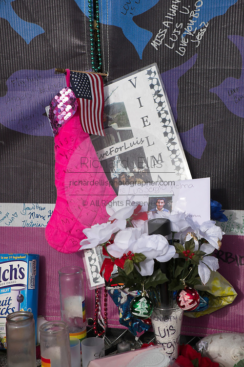 Tributes and photos are left at a makeshift memorial around the Pulse Nightclub December 18, 2016 in Orlando, Florida. On June 12, 2016 49 people were killed and 53 injured in the deadliest mass shooting by a single gunman in U.S. history, and the deadliest terrorist attack on U.S. soil since the events of September 11, 2001.