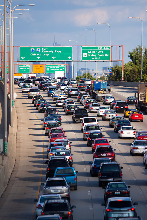 Rush hour traffic slowly crawls towards Chicago on the Kennedy Expressway.