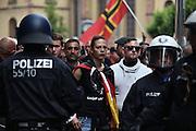 Frankfurt am Main | 20 Jun 2015<br /> <br /> Kundgebung der islamfeindlichen Gruppe &quot;Widerstand Ost West&quot; (WOW) um Ester Seitz, die Rechtspopulisten, rechte Hooligans und Neonazis vereint, auf dem Rossmarkt.<br /> Hier: Die Anmelderin Ester Seitz inmitten von Hooligans.<br /> <br /> Photo &copy; peter-juelich.com