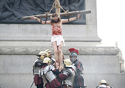 April 14, 2017 - London - Actors of the Wintershall Players perform 'The Passion of Jesus' on Good Friday to crowds in Trafalgar Square, London on 14 April 2017. The Wintershall Players are based on the Wintershall Estate in Surrey and perform several biblical theatrical productions per year. Their production of 'The Passion of Jesus' includes a cast of 80 actors, horses, a donkey and authentic costumes of Roman soldiers in the 12th Legion of the Roman Army. (Credit Image: © Tolga Akmen/London News Pictures via ZUMA Wire)