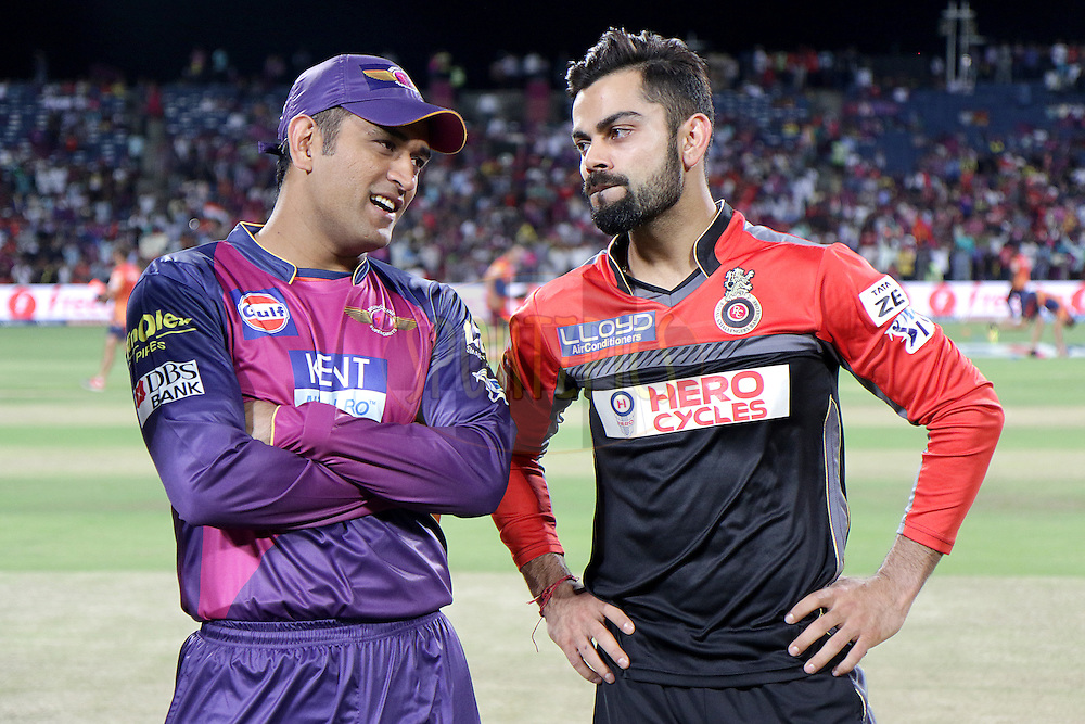 Rising Pune Supergiants captain MS Dhoni and Virat Kohli Captain  of Royal Challengers Bangalore during match 16 of the Vivo IPL 2016 ( Indian Premier League ) between the Rising Pune Supergiants and the Royal Challengers Bangalore held at the Maharashtra Cricket Association's International Stadium, Pune, India on the 22nd April 2016<br /> <br /> Photo by Rahul Gulati / IPL/ SPORTZPICS