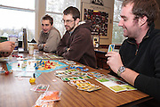 college students playing board game
