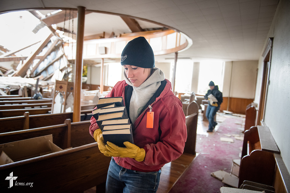 Kera Kaufman carries hymnals from Zion Lutheran Church on Monday, May 11, 2015, in Delmont, S.D. A tornado swept through the area the previous day and destroyed the church and nearby buildings. LCMS Communications/Erik M. Lunsford