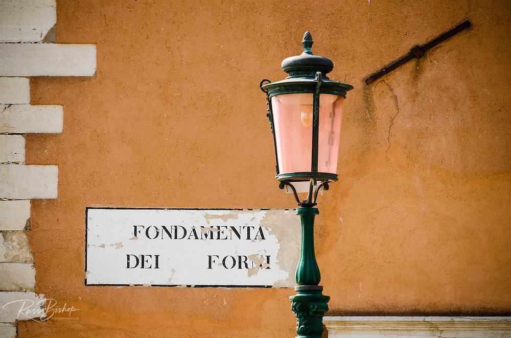 Street sign and lamp post, Venice, Veneto, Italy