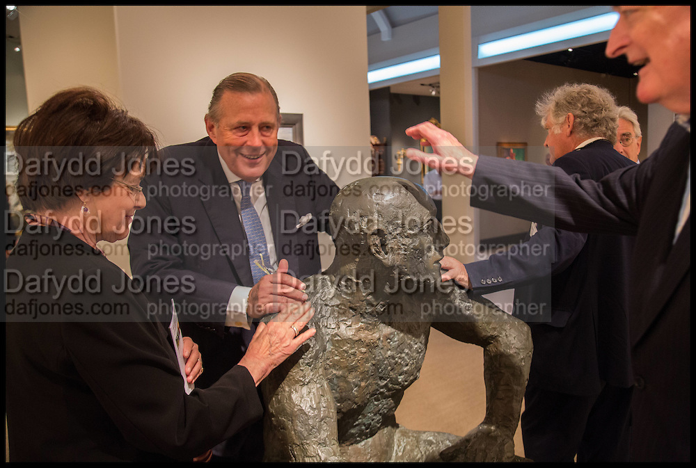 LADY SWIRE; DAVID KER; SIMON DICKINSON; SIR ADRIAN SWIRE  AROUND A SCULPTURE BY ELIZABETH FRINK, Masterpiece London 2014 Preview. The Royal Hospital, Chelsea. London. 25 June 2014.