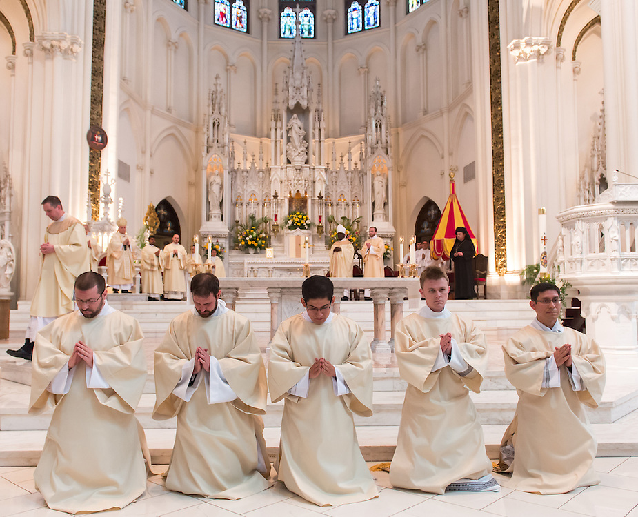 DENVER, CO - MAY 16: From left, the Rev. Gregory Louis Lesher, the Rev. Joseph Marc McLagan, the Rev. Erik Vigil Reyes, the Rev. Tomasz Strzebonski and the Rev. Franklin Anastacio Sequeira Treminio kneel during their ordination as priests for the Archdiocese of Denver at the Cathedral Basilica of the Immaculate Conception on May 16, 2015, in Denver, Colorado. (Photo by Daniel Petty/Denver Catholic Register)